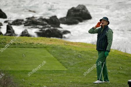 "Bill Murray yells ""Fore!"" to spectators before hitting from the eighth tee back to the sixth green of the Pebble Beach Golf Links during the third round of the AT&T Pebble Beach National Pro-Am golf tournament, in Pebble Beach, Calif"