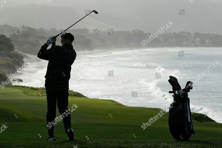 Macklemore follows his shot from the ninth fairway of the Pebble Beach Golf Links during the third round of the AT&T Pebble Beach National Pro-Am golf tournament, in Pebble Beach, Calif