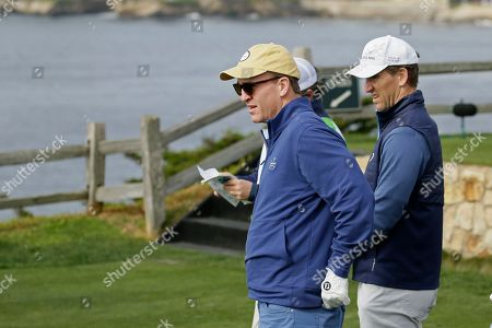 Petyon Manning, Eli Manning. Peyton Manning, left, and his brother, Eli Manning, look over the seventh green of the Pebble Beach Golf Links before hitting from the tee during the third round of the AT&T Pebble Beach National Pro-Am golf tournament, in Pebble Beach, Calif