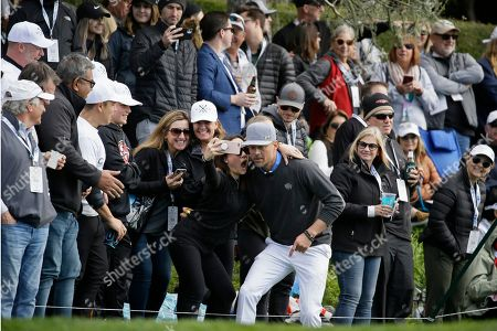 Josh Duhamel poses with fans on the 15th tee of the Pebble Beach Golf Links during the third round of the AT&T Pebble Beach National Pro-Am golf tournament, in Pebble Beach, Calif