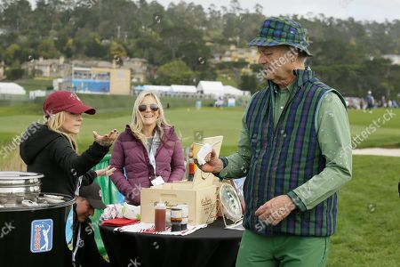 Bill Murray grabs a cup of abalone bisque while making his way to the seventh tee of the Pebble Beach Golf Links during the third round of the AT&T Pebble Beach National Pro-Am golf tournament, in Pebble Beach, Calif