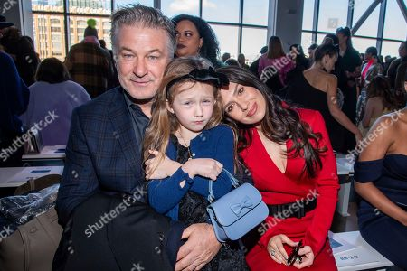 Stock Picture of Alec Baldwin, Hilaria Baldwin, Carmen Baldwin. Alec Baldwin, from left, Carmen Baldwin and Hilaria Baldwin attend the Badgley Mischka fashion show at Spring Studios during NYFW Fall/Winter 2020, in New York