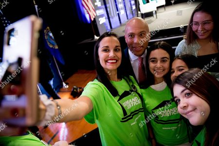 """Democratic presidential candidate former Massachusetts Gov. Deval Patrick takes a photograph with members of the audience after speaking at """"Our Rights, Our Courts"""" forum New Hampshire Technical Institute's Concord Community College, in Concord, N.H"""