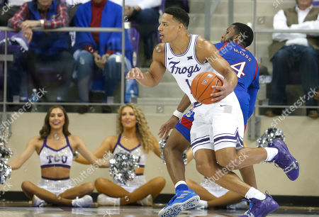 TCU guard Desmond Bane (1) drives inside past Kansas guard Isaiah Moss (4) during the second half of an NCAA college basketball game, in Fort Worth, Texas. Kansas won 60-46
