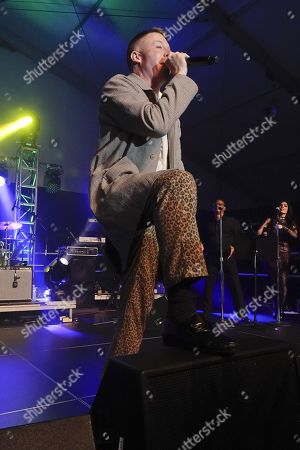 Stock Photo of Macklemore performsat the half time Volunteer party on the second day of the AT&T Pro-Am PGA Golf event at Pebble Beach