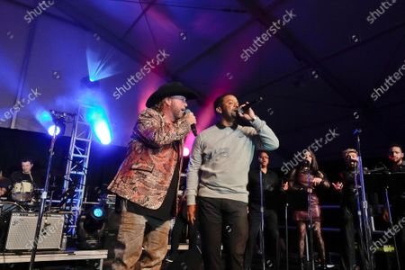 Country singing star Colt Ford performs with Alfonso Ribeiro at the half time Volunteer party on the second day of the AT&T Pro-Am PGA Golf event at Pebble Beach