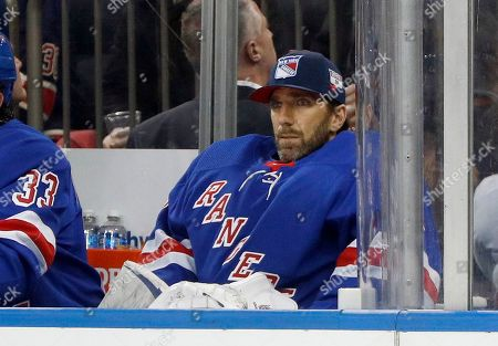 New York Rangers goaltender Henrik Lundqvist (30) looks on from the bench during an NHL hockey game against the Buffalo Sabres, in New York