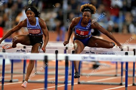 Stock Photo of Nia Ali, right, races next to Keni Harrison during the Women's 60m Hurdles at the Millrose Games track and field meet, in New York