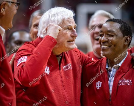 Stock Picture of Former Indiana basketball head coach Bobby Knight, left, makes his first appearance at Indiana University since his dismissal in September of 2000. Knight, along with former player Isiah Thomas, right, are on the court during a ceremony with the Indiana players of the 1980 Big Ten championship team the halftime of an NCAA college basketball game, in Bloomington, Ind