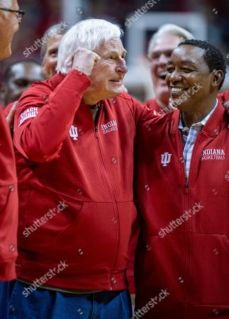 Former Indiana basketball head coach Bobby Knight, left, makes his first appearance at Indiana University since his dismissal in September of 2000. Knight, along with former player Isiah Thomas, right, are on the court during a ceremony with the Indiana players of the 1980 Big Ten championship team the halftime of an NCAA college basketball game, in Bloomington, Ind
