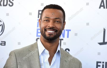 Isaiah Mustafa arrives at the 35th Film Independent Spirit Awards, in Santa Monica, Calif