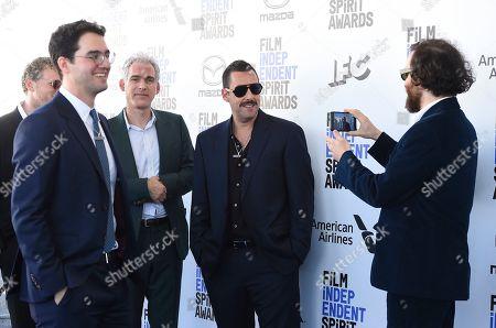Benny Safdie, Ronald Bronstein, Adam Sandler, Josh Safdie. Benny Safdie, from left, Ronald Bronstein, Adam Sandler and Josh Safdie arrive at the 35th Film Independent Spirit Awards, in Santa Monica, Calif