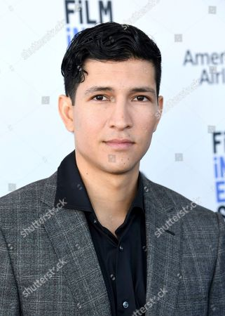 Danny Ramirez arrives at the 35th Film Independent Spirit Awards, in Santa Monica, Calif