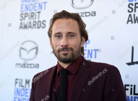 Matthias Schoenaerts arrives at the 35th Film Independent Spirit Awards, in Santa Monica, Calif