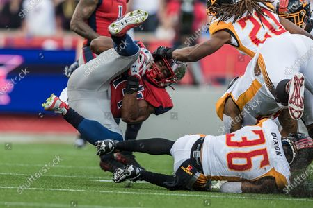 Houston Roughnecks running back Andre Williams (44) is upended by Los Angeles Wildcats safety Ahmad Dixon (36) during the XFL game between the Los Angeles Wildcats and the Houston Roughnecks at TDECU Stadium in Houston, Texas. Houston defeated Los Angeles 37-17. Prentice C