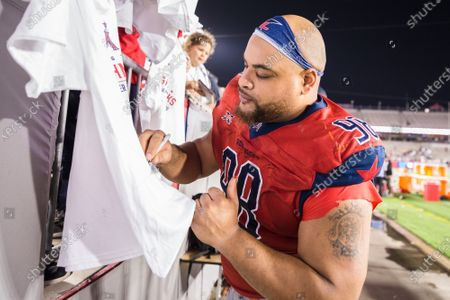 Stock Picture of Houston Roughnecks defensive lineman Nicholas James (98) signs a shirt following the XFL game between the Los Angeles Wildcats and the Houston Roughnecks at TDECU Stadium in Houston, Texas. Houston defeated Los Angeles 37-17. Prentice C