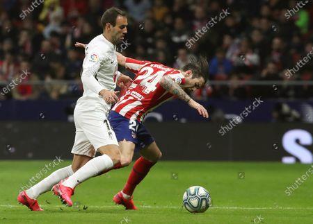 Atletico Madrid's Sime Vrsaljko (R) in action against Granada's Victor Diaz during a Spanish LaLiga soccer match between Atletico Madrid and Granada at Wanda Metrolopitano in Madrid, Spain, 08 February 2020.