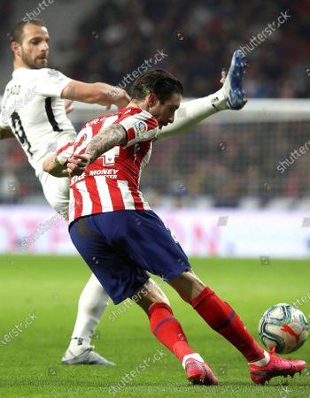 Atletico Madrid's Sime Vrsaljko (R) in action against Granada's Roberto Soldado during a Spanish LaLiga soccer match between Atletico Madrid and Granada at Wanda Metrolopitano in Madrid, Spain, 08 February 2020.