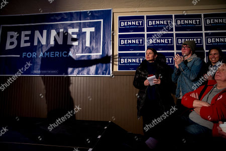 The shadow of James Carville, a political commentator known for leading former President Bill Clinton's 1992 presidential campaign, is seen as he endorses Democratic presidential candidate Sen. Michael Bennet, D-Colo., at a campaign stop at the Spotlight Room at the Palace, in Manchester, N.H
