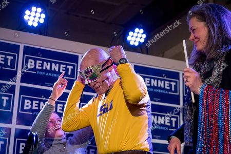 Susan Daggett, James Carville. James Carville, a political commentator known for leading former President Bill Clinton's 1992 presidential campaign, left, accompanied by Susan Daggett, the wife of Democratic presidential candidate Sen. Michael Bennet, D-Colo., right, puts on a mardi gras mask during a campaign stop at the Spotlight Room at the Palace, in Manchester, N.H