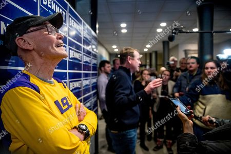 Stock Picture of Michael Bennet, James Carville. Democratic presidential candidate Sen. Michael Bennet, D-Colo., center, accompanied by James Carville, a political commentator known for leading former President Bill Clinton's 1992 presidential campaign, left, speaks to members of the media before a campaign stop at the Spotlight Room at the Palace, in Manchester, N.H