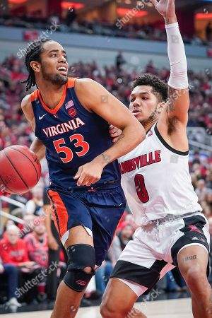 Virginia guard Tomas Woldetensae (53) drives toward the basket around Louisville guard Lamarr Kimble (0) during an NCAA college basketball game, in Louisville, Ky