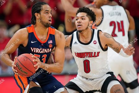 Virginia guard Tomas Woldetensae (53) plays against Louisville guard Lamarr Kimble (0) during the second half of an NCAA college basketball game, in Louisville, Ky