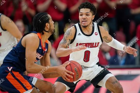 Louisville guard Lamarr Kimble (0) defends against Virginia guard Tomas Woldetensae (53) during the second half of an NCAA college basketball game, in Louisville, Ky