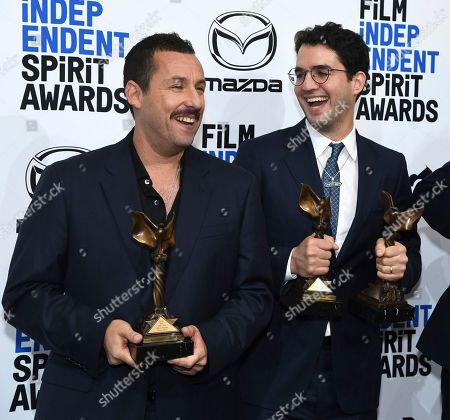 """Adam Sandler, Benny Safdie. Adam Sandler, winner of the award for best male lead, left, and Benny Safdie, winner of the awards for best editing and best director for """"Uncut Gems,"""" pose in the press room with XXX at the 35th Film Independent Spirit Awards, in Santa Monica, Calif"""