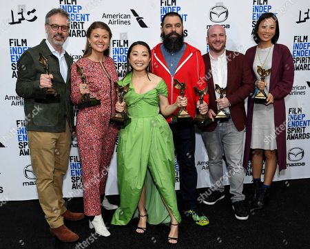 """Peter Saraf, Daniele Melia, Lulu Wang, Andrew Miano, Eddie Rubin, Anita Gou. Peter Saraf, from left, Daniele Melia, Lulu Wang, Andrew Miano, Eddie Rubin, Anita Gou pose in the press room with the award for best feature for """"The Farewell"""" at the 35th Film Independent Spirit Awards, in Santa Monica, Calif. Lulu Wang, center, also poses with the award for best supporting female for """"The Farewell,"""" which she accepted on behalf of Zhao Shuzhen"""
