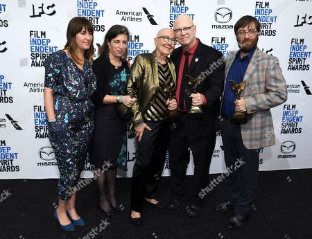 """Lindsay Utz, Julie Parker Benello, Julia Reichert, Steven Bognar, Jeff Reichert. Lindsay Utz, from left, Julie Parker Benello, Julia Reichert, Steven Bognar, and Jeff Reichert pose in the press room with their awards for best documentary for """"American Factory"""" at the 35th Film Independent Spirit Awards, in Santa Monica, Calif"""