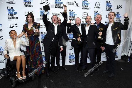 """Lauren Spencer, Alice Austen, Kirill Mikhanovsky, Sergey Shtern, Val Abel, Michael Manasseri, Walter S. Hall, Chris Galust. Lauren """"Lolo"""" Spencer, from left, Alice Austen, Kirill Mikhanovsky, Sergey Shtern, Val Abel, Michael Manasseri, Walter S. Hall, and Chris Galust pose in the press room with their John Cassavetes awards for """"Give Me Liberty"""" at the 35th Film Independent Spirit Awards, in Santa Monica, Calif"""