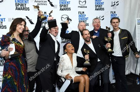 """Lauren Spencer, Alice Austen, Kirill Mikhanovsky, Sergey Shtern, Val Abel, Michael Manasseri, Walter S. Hall, Chris Galust. Alice Austen, from left, Sergey Stern, Kirill Mikhanovsky, Lauren """"Lolo"""" Spencer, Val Abel, Michael Manasseri, Walter S. Hall, and Chris Galust pose in the press room with their John Cassavetes awards for """"Give Me Liberty"""" at the 35th Film Independent Spirit Awards, in Santa Monica, Calif"""