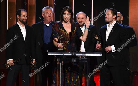 """Stock Picture of Michael Manasseri, Wally Hall, Alice Austen, Val Abel, Kirill Mikhanovsky, Sergey Shtern. Michael Manasseri, from left, Wally Hall, Alice Austen, Val Abel, Kirill Mikhanovsky, and Sergey Shtern accept the John Cassavetes award for """"Give Me Liberty"""" at the 35th Film Independent Spirit Awards, in Santa Monica, Calif"""