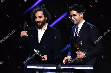 "Josh Safdie, Ben Safdie. Josh Safdie, left, and Ben Safdie accept the award for best director for ""Uncut Gems"" at the 35th Film Independent Spirit Awards, in Santa Monica, Calif"