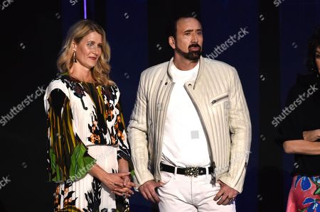 Laura Dern, Nicolas Cage. Laura Dern, left, and Nicolas Cage on stage at the 35th Film Independent Spirit Awards, in Santa Monica, Calif