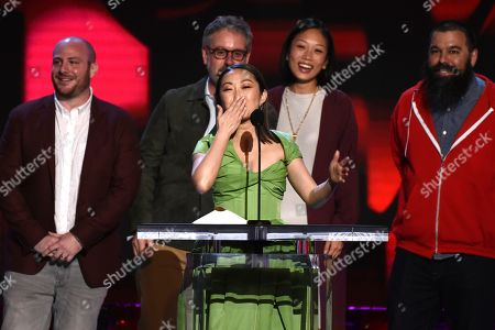 """Stock Image of Eddie Rubin, Peter Saraf, Lulu Wang, Anita Gou, Andrew Miano. Lulu Wang, center, accepts the award for best feature for """"The Farewell"""" at the 35th Film Independent Spirit Awards, in Santa Monica, Calif. Eddie Rubin, from left, Peter Saraf, Anita Gou, and Andrew Milano look on"""