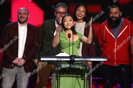 """Eddie Rubin, Peter Saraf, Lulu Wang, Anita Gou, Andrew Miano. Lulu Wang, center, accepts the award for best feature for """"The Farewell"""" at the 35th Film Independent Spirit Awards, in Santa Monica, Calif. Eddie Rubin, from left, Peter Saraf, Anita Gou, and Andrew Milano look on"""