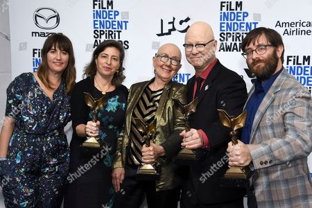 """Lindsay Utz, Julie Parker Benello, Julia Reichert, Steven Bognar, Jeff Reichert. From left, Lindsay Utz, Julie Parker Benello, Julia Reichert, Steven Bognar, and Jeff Reichert pose in the press room with their awards for best documentary for """"American Factory"""" at the 35th Film Independent Spirit Awards, in Santa Monica, Calif"""