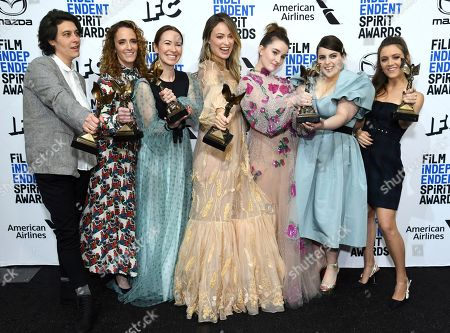 """Stock Picture of Chelsea Barnard, Susanna Fogel, Katie Silberman, Olivia Wilde, Kaitlyn Dever, Beanie Feldstein, Billie Lourd. Chelsea Barnard, from left, Susanna Fogel, Katie Silberman, Olivia Wilde, Kaitlyn Dever, Beanie Feldstein, and Billie Lourd pose in the press room with their awards for best first feature for """"Booksmart"""" at the 35th Film Independent Spirit Awards, in Santa Monica, Calif"""