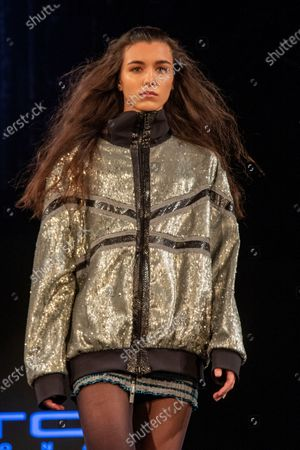 Stock Picture of A model wears clothes from the Autumn-Winter collection of the designer Custo Barcelona on the catwalk of the Angel Orensanz Foundation in New York, US, 08 February 2020. The Spanish firm Custo Barcelona celebrated on 08 February 40 years of experience in the fashion sector with a spectacular parade in a historic synagogue in New York.
