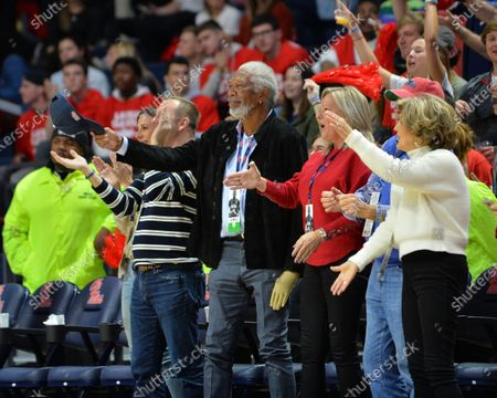 Morgan Freeman cheers with fans during the NCAA basketball game between the Florida Gators and the Ole' Miss Rebels at The Pavillion in Oxford, MS. Kevin Langley/Sports South Media/CSM