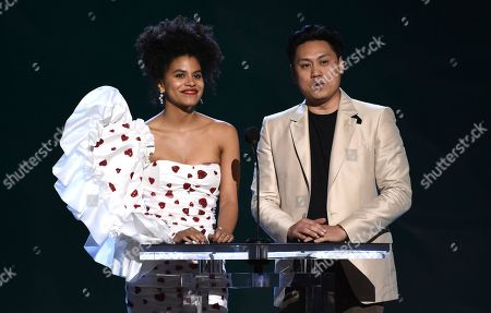 Stock Picture of Zazie Beetz, Jon M. Chu. Zazie Beetz, left, and Jon M. Chu present the award for best international film at the 35th Film Independent Spirit Awards, in Santa Monica, Calif