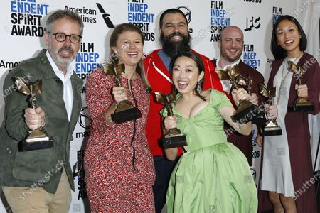 Stock Picture of Peter Saraf, Daniele Tate Melia, Lulu Wang, Andrew Miano, a guest, and Anita Gou, winners of Best Feature for 'The Farewell' pose in the press room at the 2020 Film Independent Spirit Awards in Santa Monica, California, USA, 08 February 2020. The award ceremony, organized by the non-profit organization Film Independent, honors the finest independent films of the preceding year.