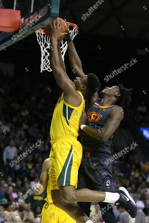 Stock Image of Baylor guard Mark Vital, left, shoots in front of Oklahoma State forward Kalib Boone during the second half of an NCAA college basketball game, in Waco, Texas