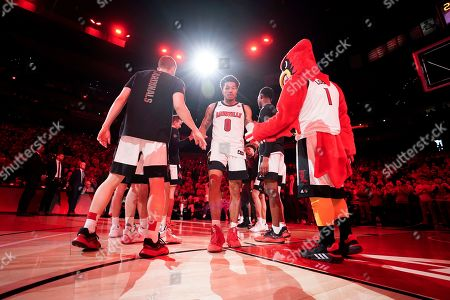Louisville guard Lamarr Kimble (0) is introduced prior to the first half of an NCAA college basketball game against Virginia, at the KFC YUM Center in Louisville, Ky