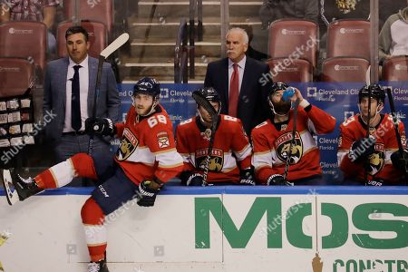 Florida Panthers head coach Joel Quenneville, watches Florida Panthers left wing Mike Hoffman (68) heads out to the ice from the bench during the third period of an NHL hockey game against the Pittsburgh Penguins, in Sunrise, Fla