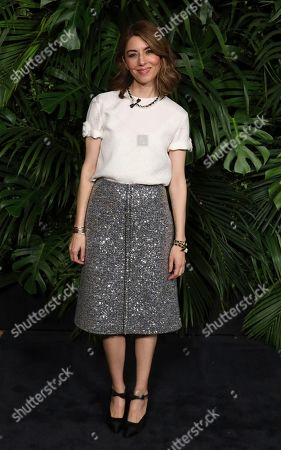Sofia Coppola arrives at the Chanel Pre-Oscar Dinner at The Beverly Hills Hotel, in Beverly Hills, Calif