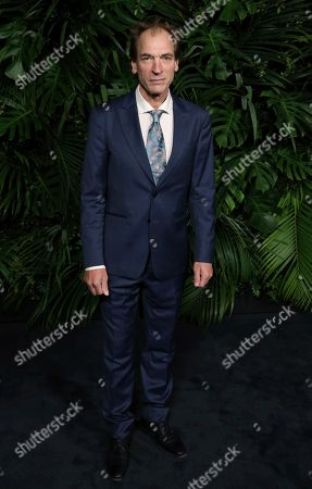 Julian Sands arrives at the 2020 Chanel Pre-Oscar Dinner at The Beverly Hills Hotel, in Beverly Hills, Calif