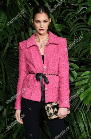 Laura Love arrives at the 2020 Chanel Pre-Oscar Dinner at The Beverly Hills Hotel, in Beverly Hills, Calif